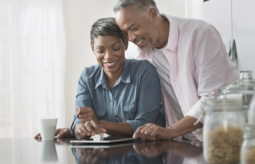 Premier AC & Heating LLC | Rock Hill, SC | couple looking at tablet in kitchen