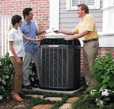 Premier AC & Heating LLC | Rock Hill, SC | couple talking to technician installing a trane unit